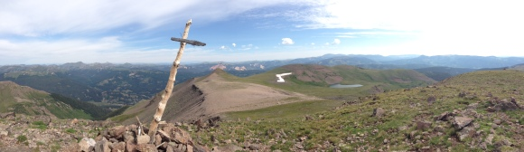 The cross sits atop Conejos Peak in Colorado, which I summitted this summer with my family.
